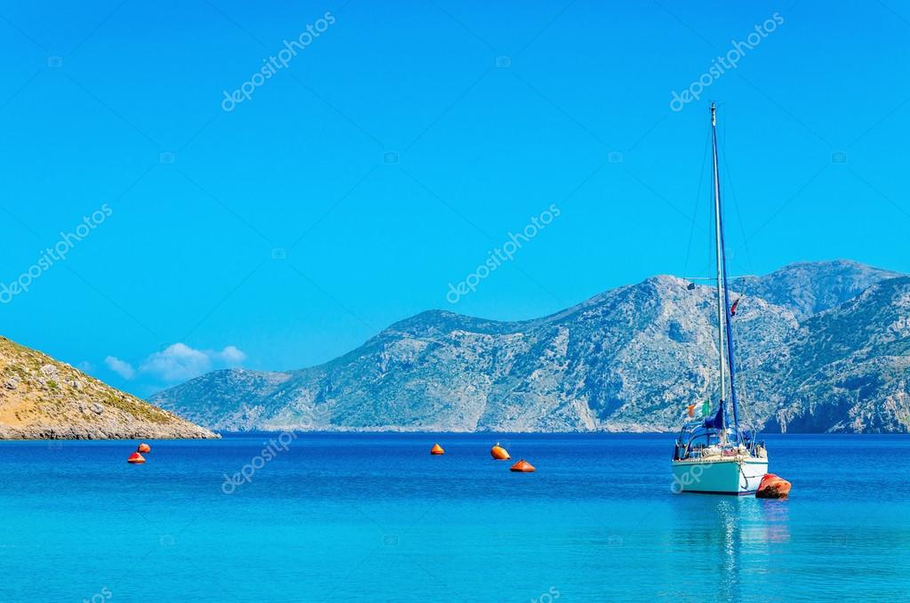 Sport yacht on anchor in bay of Greek Island