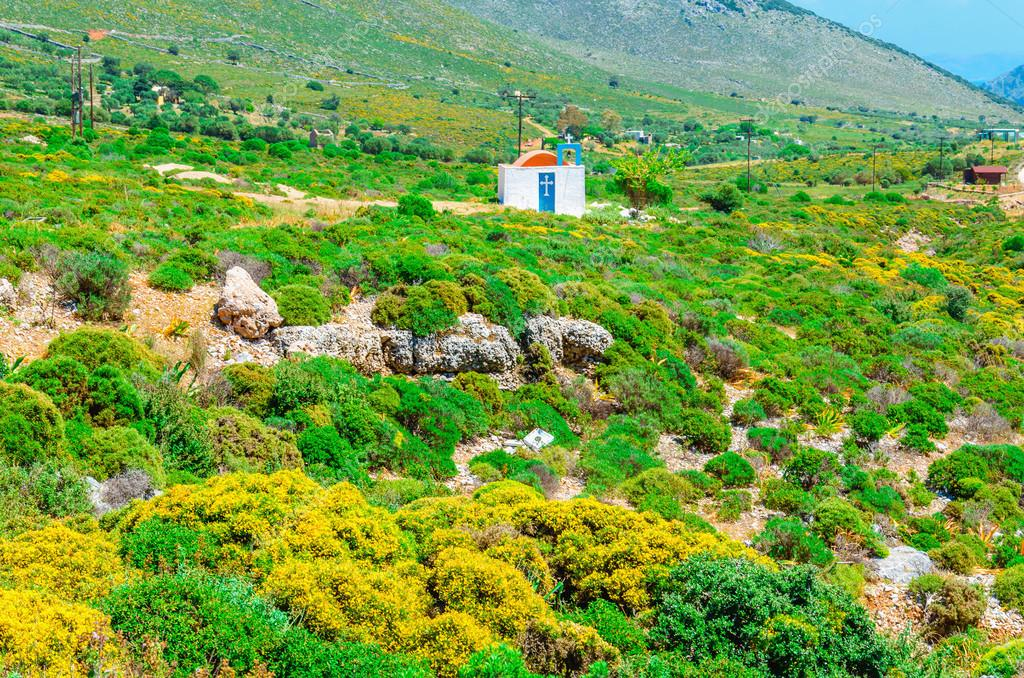 Traditional small Greek church and red roof Greece