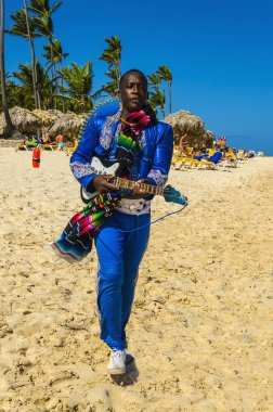 black man  singing on a Caribbean beach