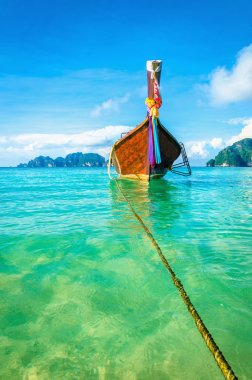 Clear water and Thai boat