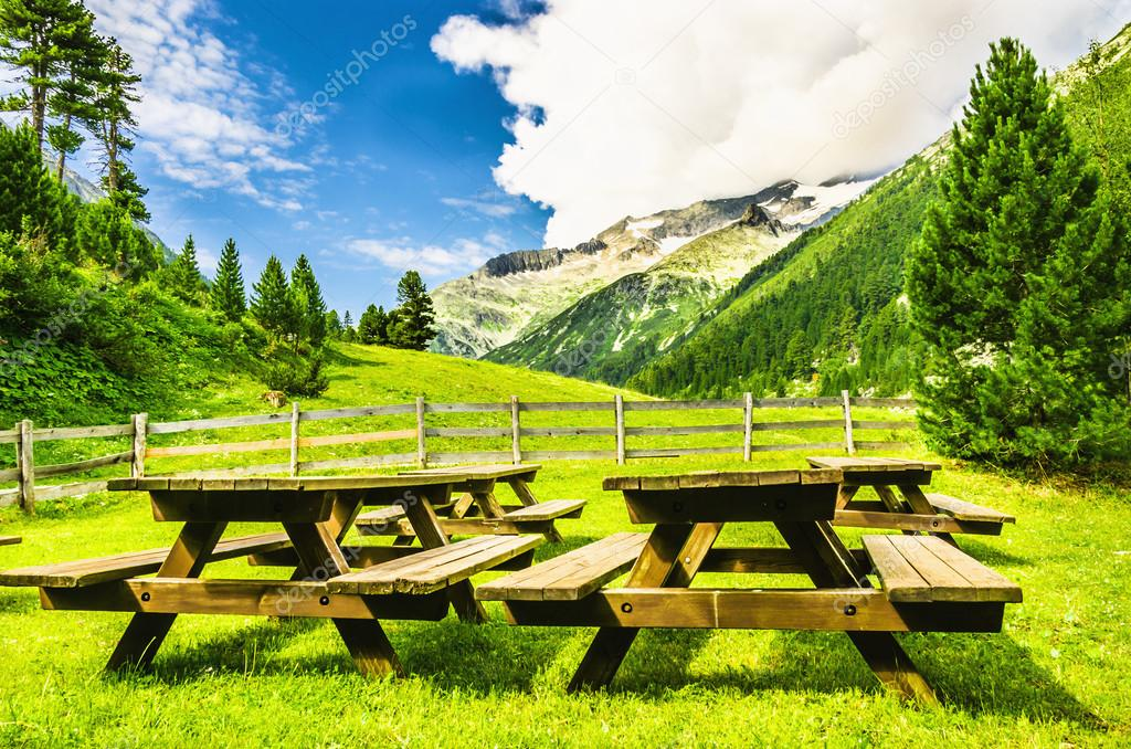 benches with tables in the   Alpine valley