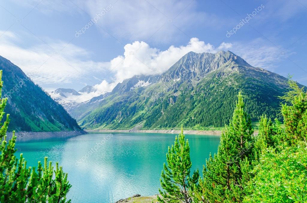 Azure mountain lake and high Alpine peaks, Austria
