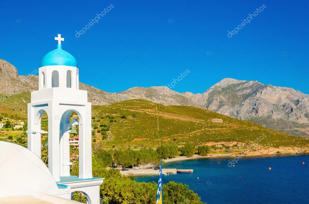 Typical Greek church with blue dome and sea Greece