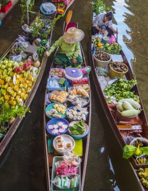 Boats with colourful fruits vegetables, Thailand