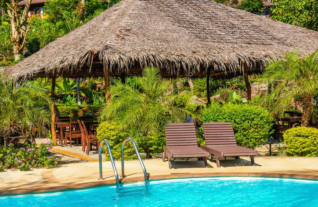 Luxury swimming pool with rattandeck chairs