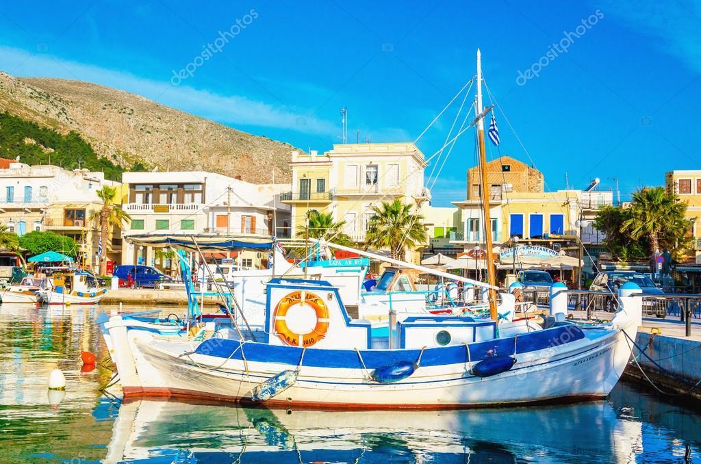 Blue-white wooden boat moored in Greek port