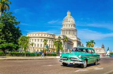 Old classic American grenn car and Capitol, Cuba