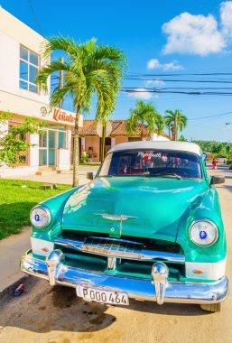 Green classic American car in Havana, Cuba