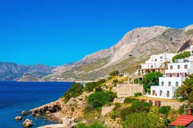 Typical Greek houses on coast of Aegean Sea Greece