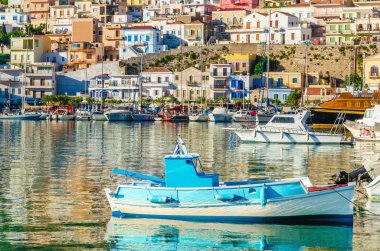 Small colorful fishermens boat in cosy Greek Port