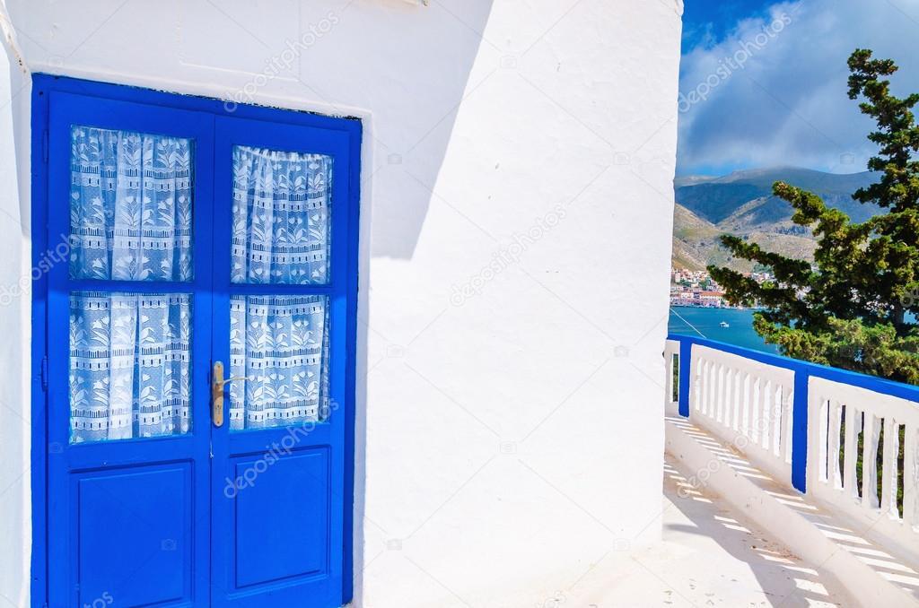 Blue door in front of Greek house, Greece