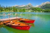Fotografie boats and Tatra Mountains high peaks