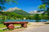 Fotografie Bench, mountain lake and peaks