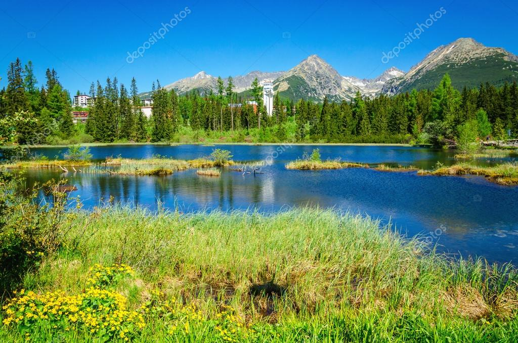 Beautiful mountain lake and high mountains peaks