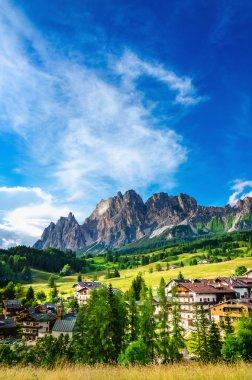 Cristallo Mountains with alpine village, Italy