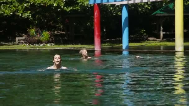 Happy family in the swimming pool