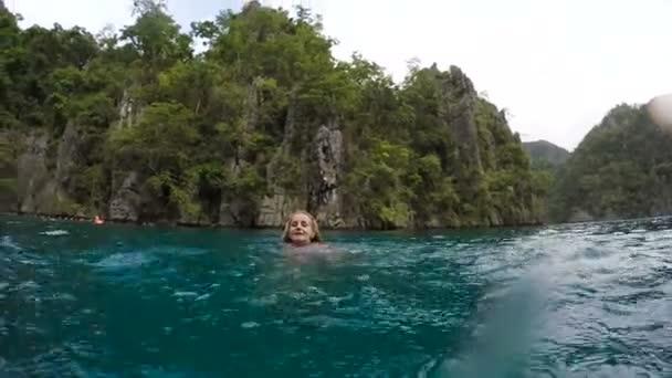 Woman splashing the water in the sea