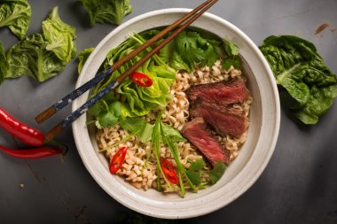 A bowl of Chinese ramen noodles with beef, Chinese cabbage, chil