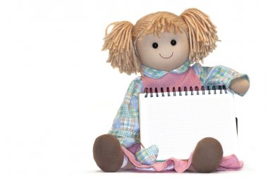 rag-doll with blank paper sheet in cage on white background