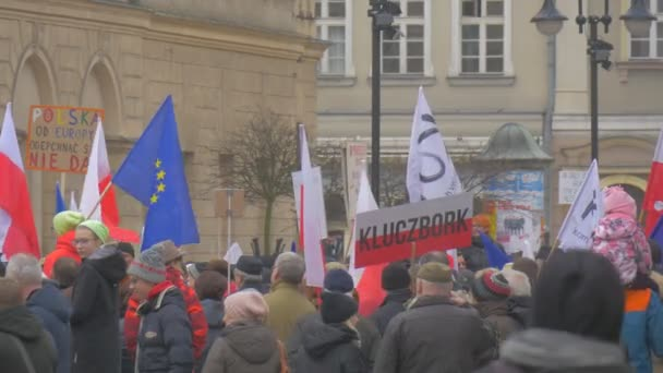 Meeting of Democracy Defense Committee Poland People Are Holding Polish Flags eu Flags Swaying With Placards Kid on Mans Neck City Square Vintage Building