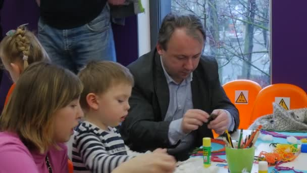 Dad Mom and Kids at Childrens Day in Library Opole Poland Parents Spend Time With Their Children Painting With Colorful Pencils Boy and Girl Are Playing