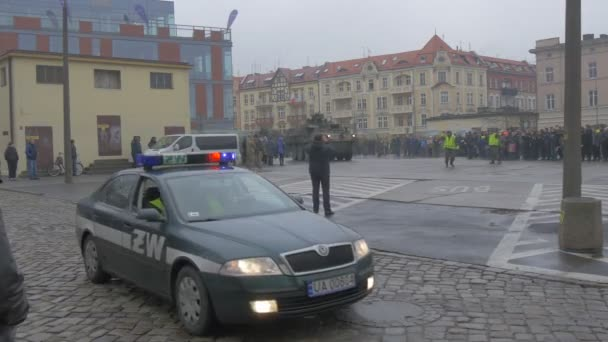 Soldiers Police Car Military Vehicles Opole Poland Atlantic Resolve Operation People Are Watching at City Square Cobblestone Old Buildings Cloudy Day