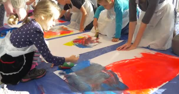 Kids Crawl by Big Sheets of Paper Painting People Paint in Kindergarten Educators Kids Animators Entertain the Children Colorful Paints Pictures Teaching