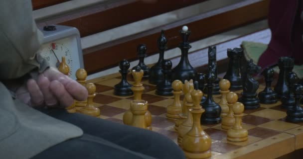 Two Men Are Sitting in Front of Each Other on The Bench, Playing Chess, Turn Chess Clocks on, Chess Board Closeup, Mens Hands, Watch on a Hand