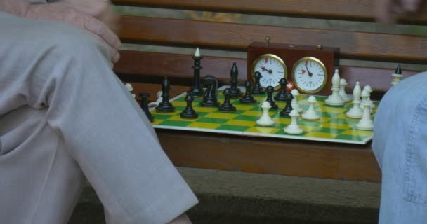 Chess Players, Green and Yellow Chess Board, white and Black Painted Chess, Two Men Are Sitting in Front of Each Other on The Bench, Board Closeup