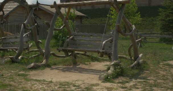 Two Wooden Swings, Swinging, Green Meadow, Hill, Fir-Tree