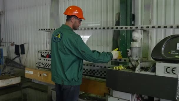 Worker in Orange Safety Helmet, Man Have Took The Sheet of Glass From The Machine, Turned the Glass, Put the Sheet another Side to the Machine