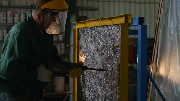 Drill Close Up, Zoom Out,Worker in Uniform And Protective Screen is Drilling the Sheet of Glass by Puncher, Glass Sheet in Metal Frame,Cracks on Glass