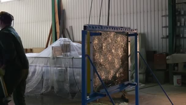 Worker In Uniform And Protective Screen, Yellow Gloves, is Beating the Glass Sheet by Hummer, Testing of Bulletproof Glass, From Behind the Sheet