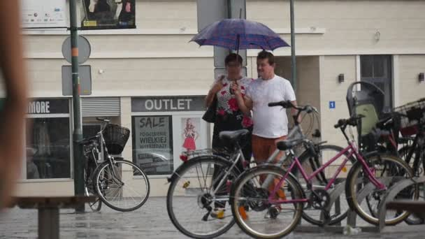 Man And Woman Walk Together In The Rain Under One Umbrella Rainy Summer Day In Opole Poland Slow Motion