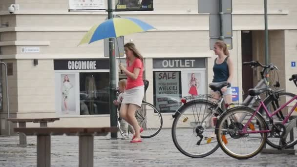 Woman With Kid Run In The Rain Under Yellow-Blue Umbrella Another Two Women Walk In The Rain Without Umbrella Downpour In Opole Poland Slow Motion
