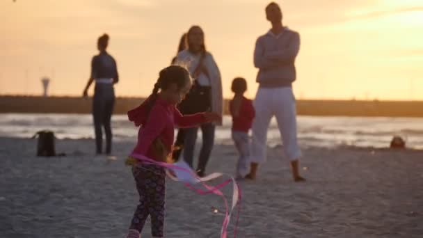 Girl Silhouette Turns Runs Flies The Small Kite Girl Is Swaying People Families Silhouettes Are Walking At Beach Kids Are Playing Kite Festival