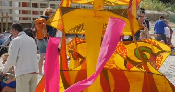 People Preparing to Fly Cartoon Heroes Kites on International Kite Festival in Leba, Poland