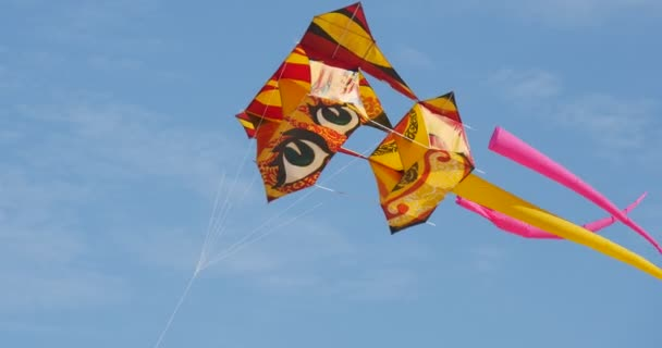Kite Parade on The International Festival in Leba, Poland. People walking flying flags and beating the drum.