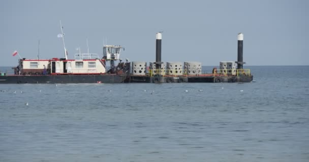 Cargo Barge Floats On The Sea Aggradation Of Soil Creation Of Dam Groynes Construction Works At The Sea Leba Poland