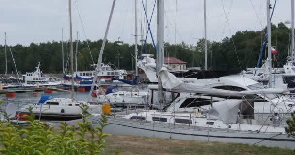 White Yachts Are Laid Up Yacht Club Port Ship Floats On The Water People Walk On The Shore Safe Harbor Calm Water Cloudy Summer Day