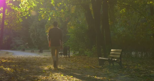 Image result for man walking away in the park