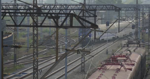 Blue Locomotive Pulls Passenger Train With White Wagons Red Electric Train And Blue Freight Train Stand On The Railway Tracks Rain Fog Opole Poland
