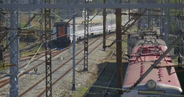 People at The Railroad Railroad Workers Passenger Train is Leaving Train is Standing Train Roof Railroad Junction Railway Station Wire Towers Cables