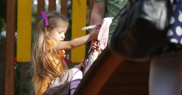 Girl Long Fair Hairs is Trying to Climb on The Chute Holding on the Rope Cannot Climb Going Down and Walking Away Sadly People at Playground Children