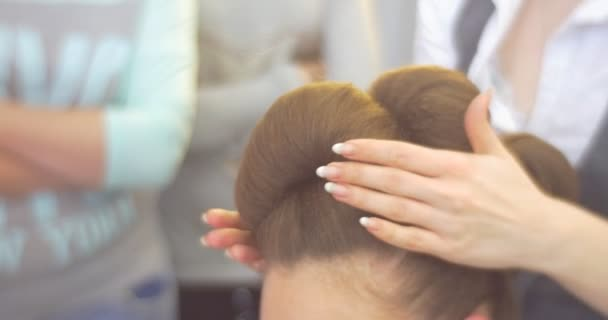 Stylist is Using Hair Fixation Spray Hairdresser is Making The Hairstyle For a Woman with Long Brown Hairs Barbershop Hairdressing Salon Beauty Salon