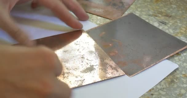 Man's Hands Are Polishing The Copper Plate Holding the Plates with Engraving Pictures of a Little Girl Process of Creating an Engraved Picture