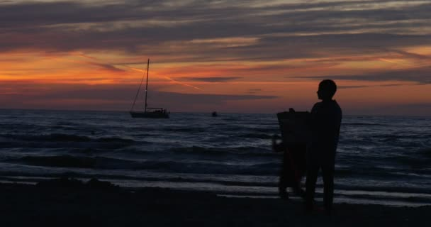Children Boys Are Flying The Kites Running People Families Silhouettes Are Walking by Sandy Beach Lifeguard Tower Bright Sunset Waves on the Sea Yacht