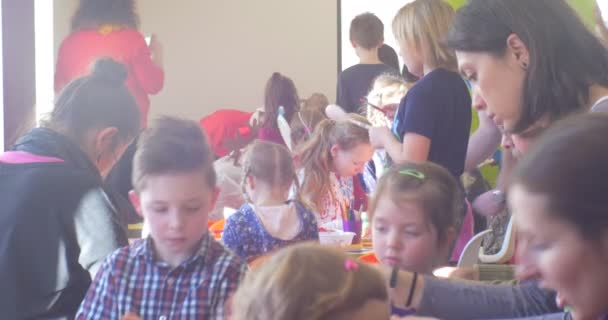 Large Group of Kids is Sitting at The Tables Making a New Year's Winter Appliques Educators Help the Kids Santa Claus Classroom of Kindergarten
