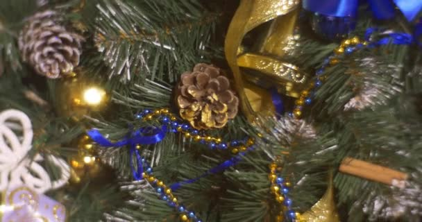 Christmas Tree Decorated With Blue Golden Ribbons Bows Christmas Balls Toys Decorated New Years Tree Cones on Evergreen Branches Panorama of a Tree