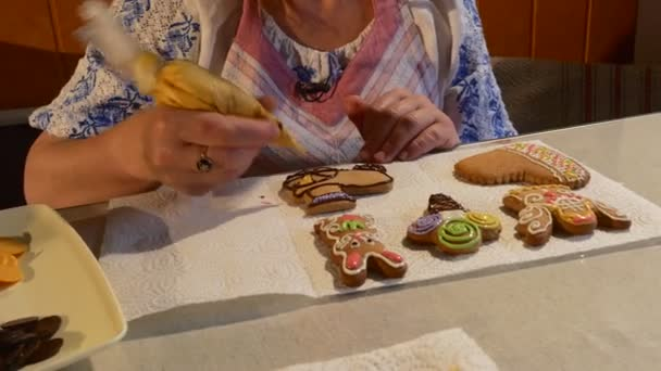Woman is Painting a Cookie With Yellow Mastique Woman is Decorating a Christmas Cookies Biscuits Decorated with Colorful Mastique on a Table Chocolate